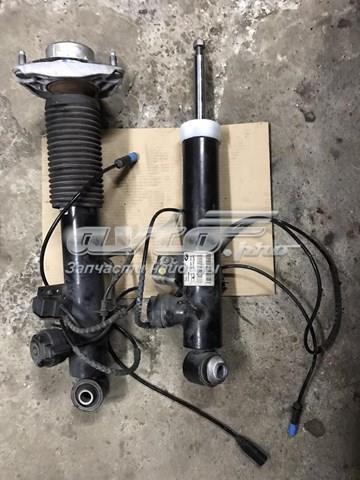 амортизатор задній, правий  37106875090